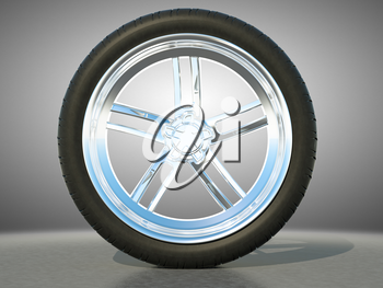 Automotive alloy wheel with tire and studio light background