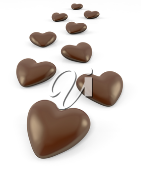Few heart shaped chocolate candies, isolated on white background