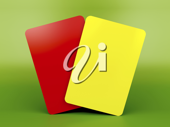 Red and yellow cards on green background