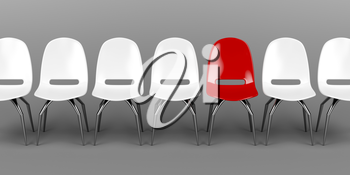 One unique red chair in a row of white chairs