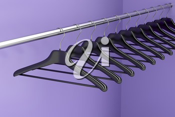 Plastic hangers hanging on rod in the closet
