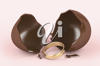 Broken chocolate egg with a surprise, golden engagement ring inside