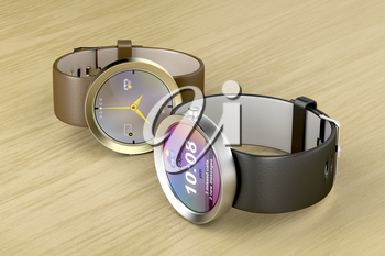 Silver and gold luxury smart watches on wood table