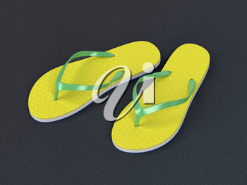 Yellow flip flops on the asphalt