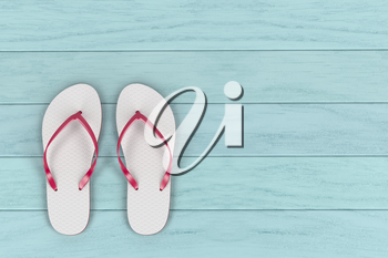 White flip flops on wooden floor, top view
