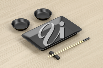 Chopsticks and black empty plates for sushi on wooden table