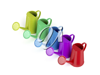 Colorful watering cans on white background