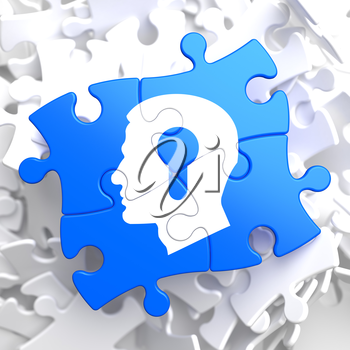 Psychological Concept - Profile of Head with a Keyhole Located on Blue Puzzle Pieces.