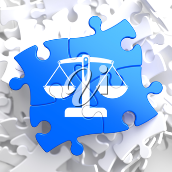 Justice Concept - Icon of Scales in Balance- Located on Blue Puzzle Pieces.