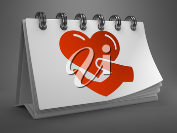 White Desktop Calendar with Red Icon of Heart in the Hand on Gray Background. Charity Concept.