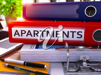 Red Office Folder with Inscription Apartments on Office Desktop with Office Supplies and Modern Laptop. Apartments Business Concept on Blurred Background. Apartments - Toned Image. 3D