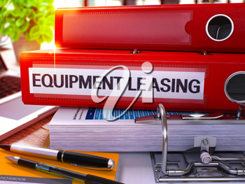 Red Office Folder with Inscription Equipment Leasing on Office Desktop with Office Supplies and Modern Laptop. Equipment Leasing Business Concept on Blurred Background. 3D Render
