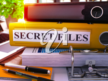 Yellow Office Folder with Inscription Secret Files on Office Desktop with Office Supplies and Modern Laptop. Secret Files Business Concept on Blurred Background. Secret Files - Toned Image. 3D.