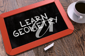 Hand Drawn Learn Geometry Concept  on Small Red Chalkboard. Business Background. Top View. 3D Render.