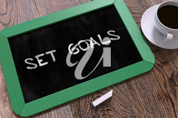 Hand Drawn Set Goals Concept  on Small Green Chalkboard. Business Background. Top View. 3D Render.