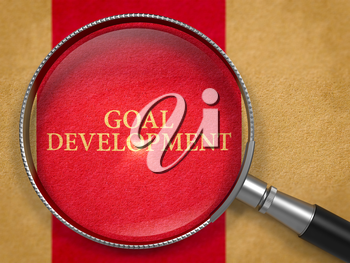Goal Development Concept through Magnifier on Old Paper with Dark Red Vertical Line Background. 3D Render.