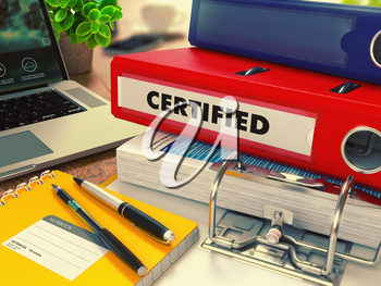 Red Office Folder with Inscription Certified on Office Desktop with Office Supplies and Modern Laptop. Business Concept on Blurred Background. Toned Image. 3D Render.
