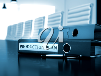 Production Plan - Business Illustration. File Folder with Inscription Production Plan on Working Desktop. Production Plan. Illustration on Blurred Background. 3D.