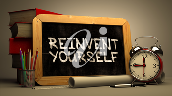 Reinvent Yourself Handwritten on Chalkboard. Time Concept. Composition with Chalkboard and Stack of Books, Alarm Clock and Scrolls on Blurred Background. Toned Image. 3D Render.