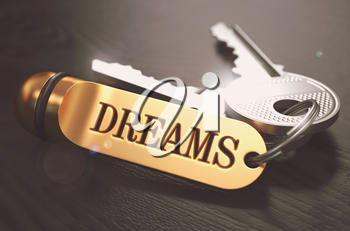 Keys to Dreams - Concept on Golden Keychain over Black Wooden Background. Closeup View, Selective Focus, 3D Render. Toned Image.