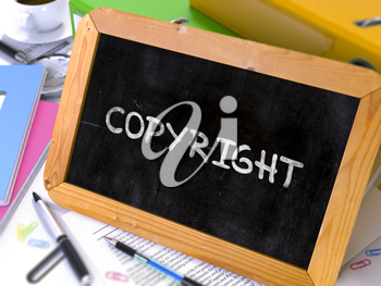 Copyright Concept Hand Drawn on Chalkboard on Working Table Background. Blurred Background. Toned Image. 3D Render.