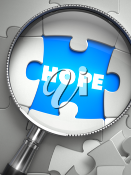 Hope - Word on the Place of Missing Puzzle Piece through Magnifier. Selective Focus. 3D Render.