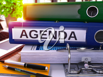 Agenda - Blue Office Folder on Background of Working Table with Stationery and Laptop. Agenda Business Concept on Blurred Background. Agenda Toned Image. 3D.