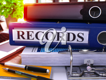 Blue Office Folder with Inscription Records on Office Desktop with Office Supplies and Modern Laptop. Records Business Concept on Blurred Background. Records - Toned Image. 3D.