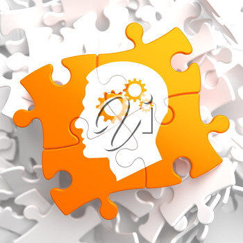 Psychological Concept - Profile of Head with Cogwheel Gear Mechanism Located on Orange Puzzle.