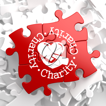 Charity Word Written Arround Icon of Heart in the Hand, Located on Red Puzzle. Social Concept.