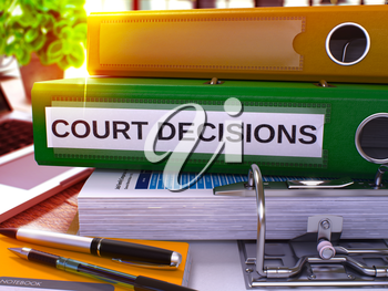 Green Office Folder with Inscription Court Decisions on Office Desktop with Office Supplies and Modern Laptop. Court Decisions Business Concept on Blurred Background. 3D Render.