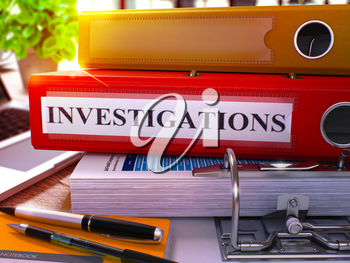Red Ring Binder with Inscription Investigations on Background of Working Table with Office Supplies and Laptop. Investigations Business Concept on Blurred Background. 3D Render.