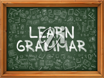 Learn Grammar - Handwritten Inscription by Chalk on Green Chalkboard with Doodle Icons Around. Modern Style with Doodle Design Icons. Learn Grammar on Background of  Green Chalkboard with Wood Border.
