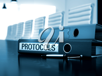 Protocols. Illustration on Blurred Background. Protocols - Office Binder on Black Table. Binder with Inscription Protocols on Wooden Table. 3D.