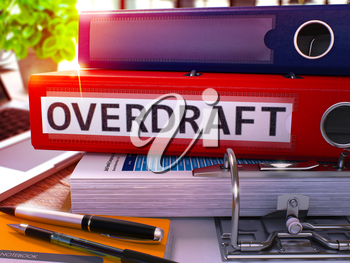 Red Office Folder with Inscription Overdraft on Office Desktop with Office Supplies and Modern Laptop. Overdraft Business Concept on Blurred Background. Overdraft - Toned Image. 3D.
