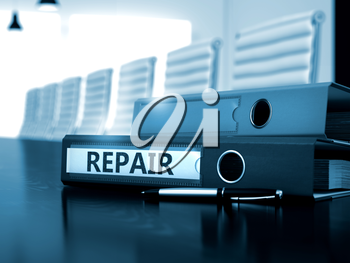 Repair - Business Concept on Blurred Background. Folder with Inscription Repair on Wooden Desktop. 3D.