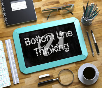 Small Chalkboard with Bottom Line Thinking. Bottom Line Thinking - Text on Small Chalkboard.3d Rendering.