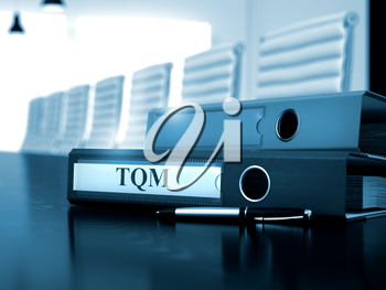 TQM. Concept on Blurred Background. File Folder with Inscription TQM on Desktop. TQM - Office Folder on Office Wooden Desktop. 3D Render.