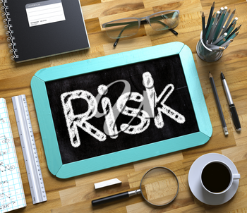 Risk. Business Concept Handwritten on Mint Small Chalkboard. Top View Composition with Chalkboard and Office Supplies on Office Desk. Risk - Text on Small Chalkboard.3d Rendering.