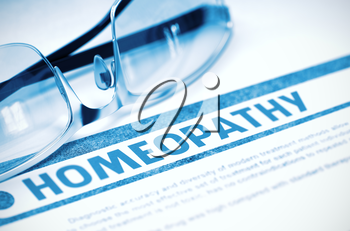 Homeopathy - Medicine Concept with Blurred Text and Eyeglasses on Blue Background. Selective Focus. 3D Rendering.