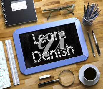 Learn Danish Handwritten on Blue Chalkboard. Top View Composition with Small Chalkboard on Working Table with Office Supplies Around. Learn Danish Concept on Small Chalkboard. 3d Rendering.