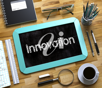 Innovation. Business Concept Handwritten on Mint Small Chalkboard. Top View Composition with Chalkboard and Office Supplies on Office Desk. Innovation Concept on Small Chalkboard. 3d Rendering.