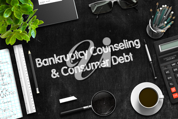 Bankruptcy Counseling and Consumer Debt - Black Chalkboard with Hand Drawn Text and Stationery. Top View. 3d Rendering.