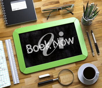 Green Small Chalkboard with Handwritten Business Concept - Book Now - on Office Desk and Other Office Supplies Around. Top View. Book Now Concept on Small Chalkboard. 3d Rendering.