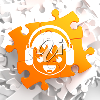 Happy Boy with Headphones Icon on Orange Puzzle. Sound, Music Concept.