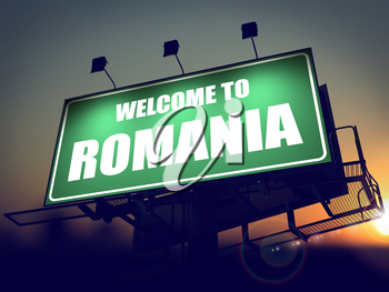 Welcome to Romania - Green Billboard on the Rising Sun Background.