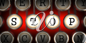Stop on Old Typewriter's Keys on Red Background.