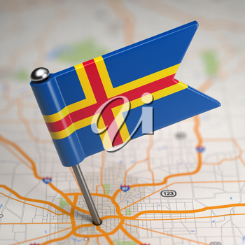 Small Flag of Aland Islands on a Map Background with Selective Focus.