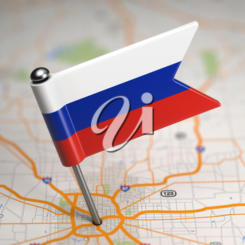 Small Flag of Russia Sticked in the Map Background with Selective Focus.