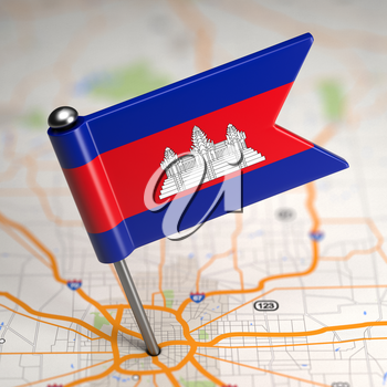 Small Flag of Cambodia Sticked in the Map Background with Selective Focus.